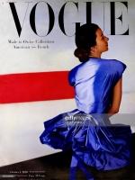 Model Dorian Leigh seen from rear wearing blue gown *** Local Caption *** Dorian Leigh;